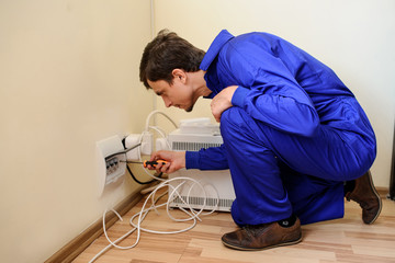 Man is repair the electrical installation