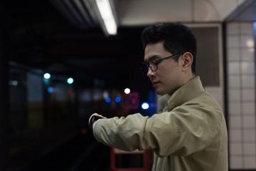 Man checking time at railway station