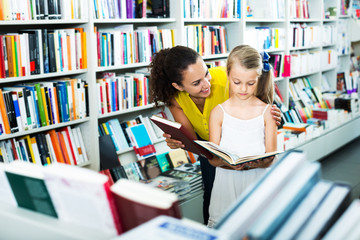 Mother with daughter in bookstore