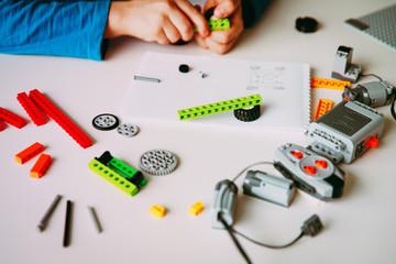 boy building robot at robotic technology school lesson