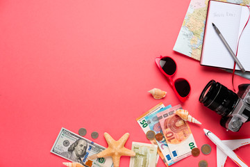 Plane and money on a pink background.  Travel concept.