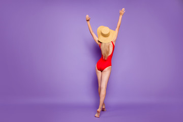 Tourism suntan people person concept. Rear behind view photo of excited cheerful rejoicing lady moving on sand to the sea wants to get suntan isolated violet purple color bright background copy space