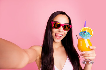 Follow me subscribers! Social influencer concept. Close up studio photo portrait of cool hipster nice carefree lady holding juice in hand taking selfie isolated bright pastel background