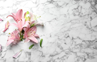 Flat lay composition with lily flowers on marble background