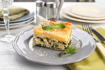 Lasagna with spinach served on table