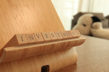 TOKYO, JAPAN. 2018 July 20th. Wooden Block Text of  Investment