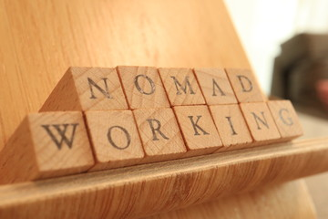 TOKYO, JAPAN. 2018 July 20th. Wooden Block Text of Nomad Working