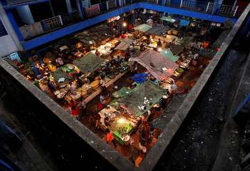 Vendors sell fish at a retail fish market in Kolkata