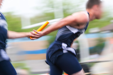 Motion blurred relay race at a track and field event