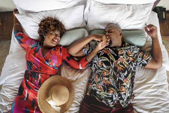 African American couple relaxing on a bed
