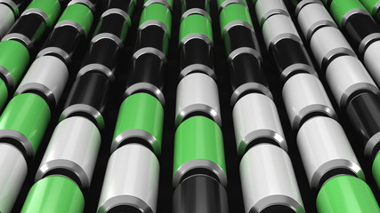 Raws of black, white and green soda cans