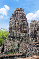 Tower with Buddha images in the temple of Angkor Tom in Cambodia.