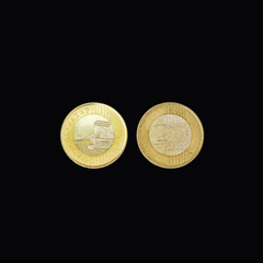 front and back of a coin of 200 Hungarian forints on a black background
