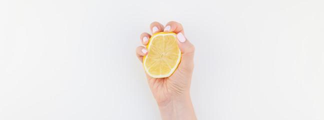 Woman hand with lemon