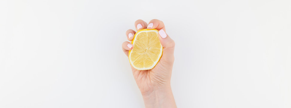 Woman hand with lemon