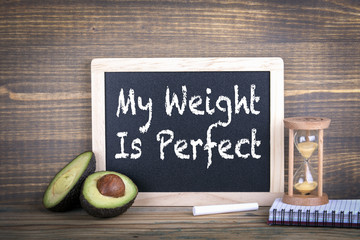 my weight is perfect. Fitness, healthy eating and veganism. Chalkboard on a wooden background