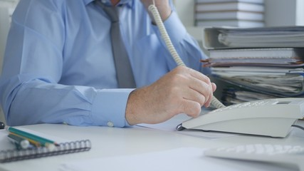 Businessman Image Using Office Landline Phone in Accounting Archive