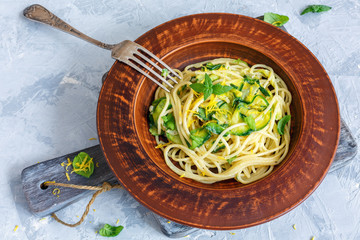 Spaghetti with zucchini and fresh mint.