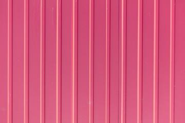 Red metal sheet metal profile as background