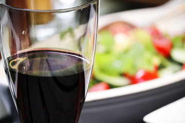 Glass of red wine and salad
