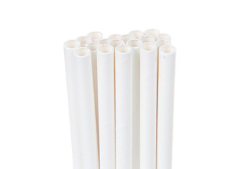 Close up on white paper straws facing upwards isolated on white background.  ecologically friendly yet durable paper drinking straws.