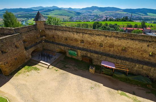 Stara Lubovna, Slovakia - AUG 28, 2016: inner courtyard of old medieval castle. popular tourist destination. big chess desk in the corner
