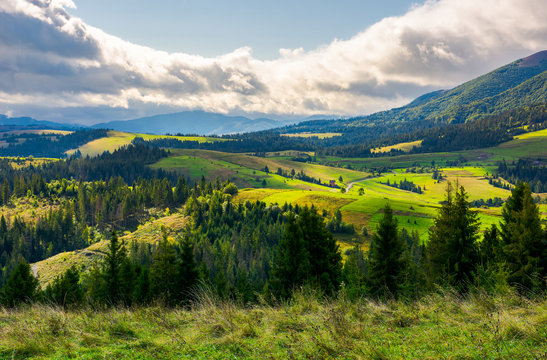 lovely rural area in mountains. huge cloud formation over the distant ridge. picturesque scenery of Carpathian alps