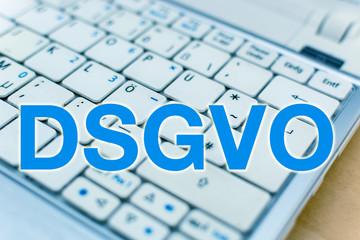 Letters DSGVO in front of Laptop Keyboard, German: Datenschutzgrundverordnung