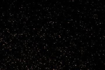 красивый блестящий черный фон из блесток и боке