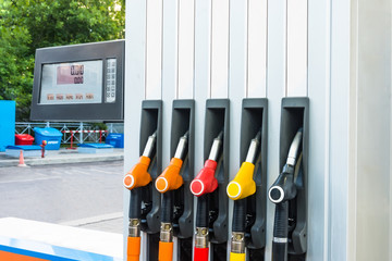 Gasoline filling, view of the gas station and pistols with fuel for cars, scoreboard price and quantity of fuel. Concept of the cost of fuel for automobile.