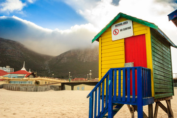 Colourful wooden huts on Muizenberg beach, Cape Town, South Africa.