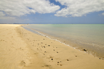 Clear tuquoise waters of Atlantic Ocean on Sotavento beach on Fuerteventura, Canary Islands