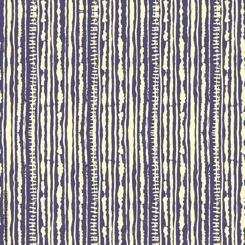 Seamless vector shibori tie-dye pattern of yellow color on