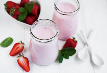 Jars with strawberry yogurt
