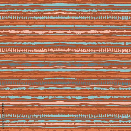 Seamless vector shibori tie-dye pattern of warm colours