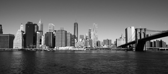 Manhattan skyline in new york city at East river with brookly bridge