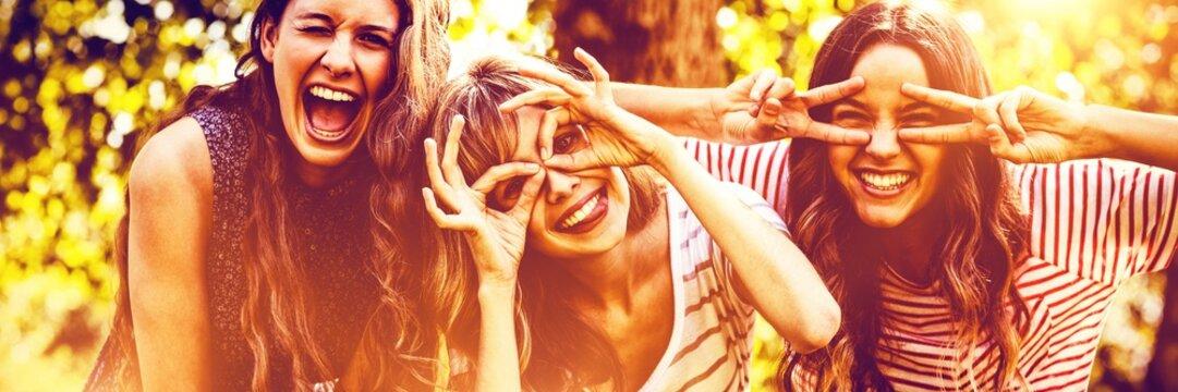 Portrait of happy friends taking selfie