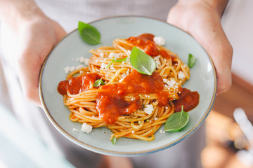 Young man holding eating tasty italian pasta. Healthy eating concept