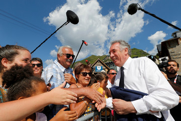 Francois Bayrou, leader of Mouvement Democrate, greets people as he arrives to visit the Pic du Midi at La Mongie in Bagneres-de-Bigorre