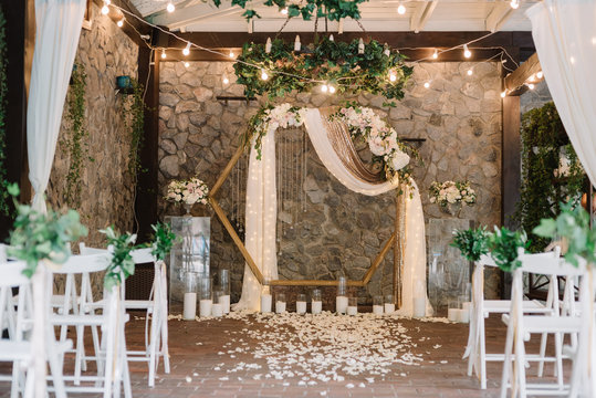 Magnificent decoration of a wedding ceremony with original details and candles.