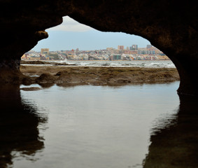 Las Palmas de Gran Canaria, seen from  hole in the rock during low tide, Canary islands