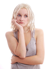 young woman with blonde dreadlocks looking sad and depressed