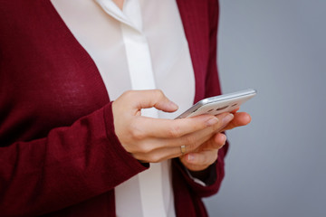 Close up of women's hands holding cell telephone with blank copy space