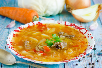 Traditional ukrainian or russian soup borscht borsch shchi with meat and young vegetables in bowl close up