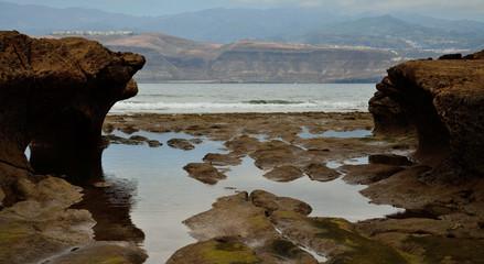 El Confital, reefs of sandstone and low tide, coast of Las Palmas de Gran Canaria, Canary Islands