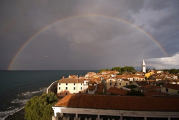 Complete rainbow over Novigrad in the morning, Istria, Croatia, Europe