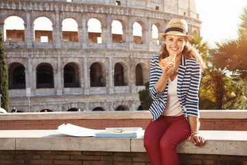 happy modern tourist woman in Rome, Italy eating pizza
