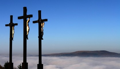 Three crucifixes over a blanket of mist, Kreuzberg, Rhoen Mountains, Bavaria, Germany, Europe