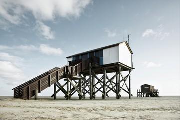 Stilt buildings on the beach of St. Peter-Ording, Schleswig-Holstein, Germany, Europe