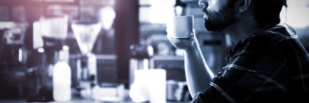 Side view of man drinking coffee